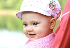 Happy smiling baby in hat looking Stock Image