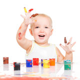 Happy smiling baby with a painted hands Royalty Free Stock Photos
