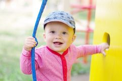 Happy smiling baby on playground. Happy smiling baby age of 10 months on playground Royalty Free Stock Photography