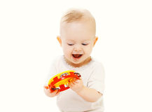 Happy smiling baby playing with toy on white background Stock Photography