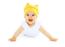 Happy smiling baby in yellow hat. Having fun Stock Photos