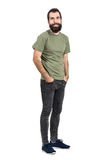 Happy smiling bearded hipster with hands in pockets. Full body length portrait isolated over white studio background Royalty Free Stock Image