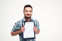 Happy smiling bearded man in checkered shirt holding blank clipboard Stock Photo