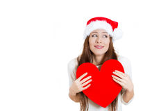 Happy smiling beautiful, adorable woman in red santa claus hat looking sideways Stock Image