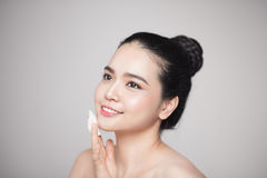 Happy smiling beautiful asian woman using cotton pad cleaning sk Stock Image