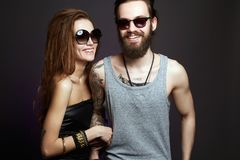 Happy smiling beautiful couple in sunglasses stock images
