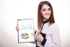 Happy smiling beautiful young business woman showing clipboard Stock Images