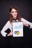 Happy smiling beautiful young business woman showing  clipboard Stock Photo