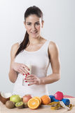 Happy and smiling beautiful young woman enjoying a glass milk. Royalty Free Stock Image