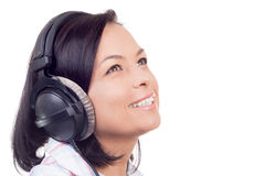 Happy Smiling Beautiful Young Woman Listening Music with Headpho Stock Photo