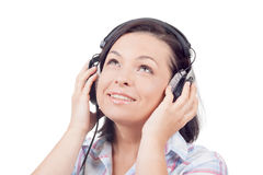 Happy Smiling Beautiful Young Woman Listening Music with Headpho Royalty Free Stock Photography