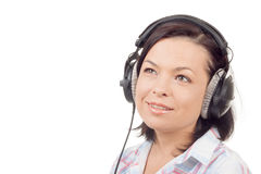 Happy Smiling Beautiful Young Woman Listening Music with Headpho Royalty Free Stock Photo