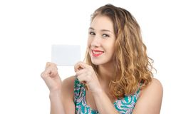 Happy smiling beautiful young woman showing blank signboard or c stock photography
