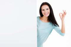 Happy smiling beautiful young woman showing blank signboard Stock Photography