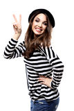 Happy smiling beautiful young woman showing okay gesture, isolated over white Stock Photo