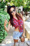 Happy smiling beautiful young woman showing two fingers or victo Stock Images