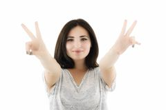 Happy smiling beautiful young woman showing two fingers or victo Stock Photos