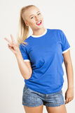 Happy smiling beautiful young woman showing two fingers or victory gesture, isolated over white background Stock Photos