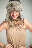 Happy smiling beauty woman wearing fur hat and collar Stock Images