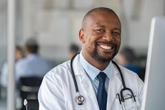 Free Happy Smiling Black Doctor Looking At Camera Stock Photos - 164999333
