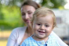 Happy smiling blond baby boy outdoors stock image