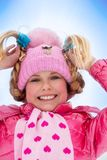 Happy smiling blond girl with funny braids Royalty Free Stock Photography