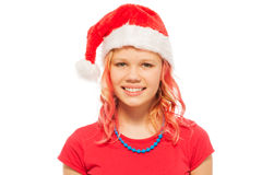 Happy smiling blond girl in Santa Christmas hat Stock Photos