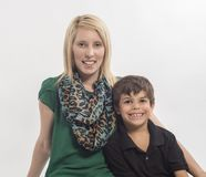 Young mother and interracial son on white background stock photos