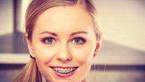 Happy smiling blonde woman having braces Stock Images