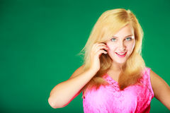 Happy smiling blonde woman in pink top. Dyeing, hairstyling, feminity, female beauty concept. Happy blonde woman in pink top holding hand close to her face stock images
