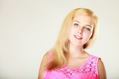 Happy smiling blonde woman in pink top. Dyeing, hairstyling, feminity, female beauty concept. Happy blonde woman in pink top. Studio shot on white background stock photography
