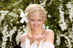 Happy Smiling blonde young woman presentation. Hands Royalty Free Stock Photography