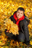 Happy smiling boy with autumn leaves Royalty Free Stock Photography
