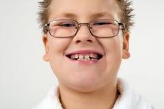 Happy smiling boy in bathrobe. Closeup portrait stock image