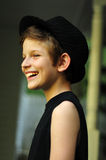 Happy smiling boy in a black hat Stock Photos