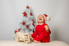 Happy smiling boy by Christmas tree Royalty Free Stock Images