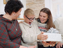 Happy smiling boy enjoying Christmas gift from his family Royalty Free Stock Photos
