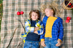 Happy smiling boy and girl lying together on rug Royalty Free Stock Images