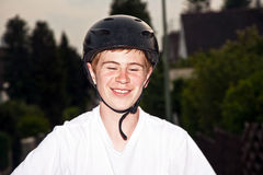 Happy smiling  boy with helmet Stock Images