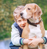 Happy smiling boy with his dog Stock Image