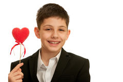 Happy smiling boy holding red heart Stock Photo