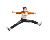 Happy smiling boy jumping in air Stock Photos