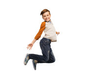 Happy smiling boy jumping in air Royalty Free Stock Image