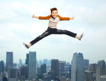 Happy smiling boy jumping in air Stock Images