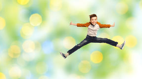 Happy smiling boy jumping in air Stock Photography