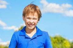 Happy smiling boy outside stock photography