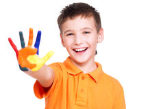Happy smiling boy with a painted hand. Royalty Free Stock Photo
