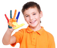 Happy smiling boy with a painted hand. Stock Photo