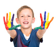 Happy smiling Boy with a painted hands. Royalty Free Stock Photography