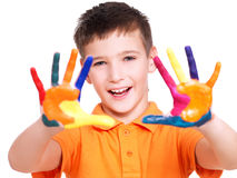 Happy smiling boy with a painted hands. Royalty Free Stock Photo